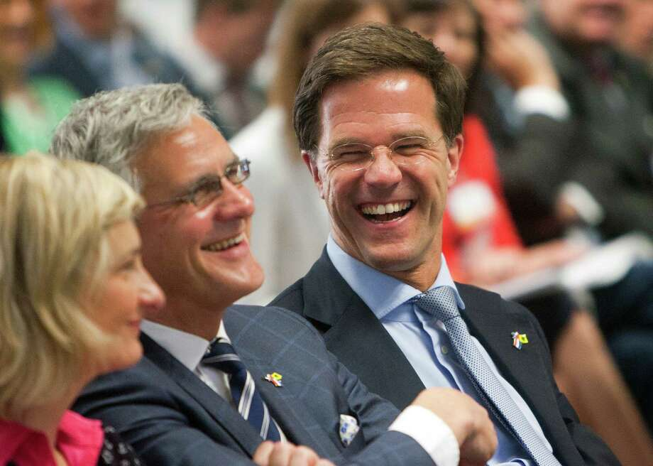 Flemish Minister of Mobility and Public Works Hilde Crevits, left, Minister-President of the Flemish Government Kris Peeters, center and Netherlands Prime Minister Mark Rutte laugh at a remark during a discussion at the Pennzoil Place, Tuesday, July 9, 2013, in Houston. Top government officials from the Netherlands and Belgium visited with Shell executives as Shell explained their nations' oil field expertise. (Cody Duty / Houston Chronicle) Photo: Cody Duty, Staff / © 2013 Houston Chronicle