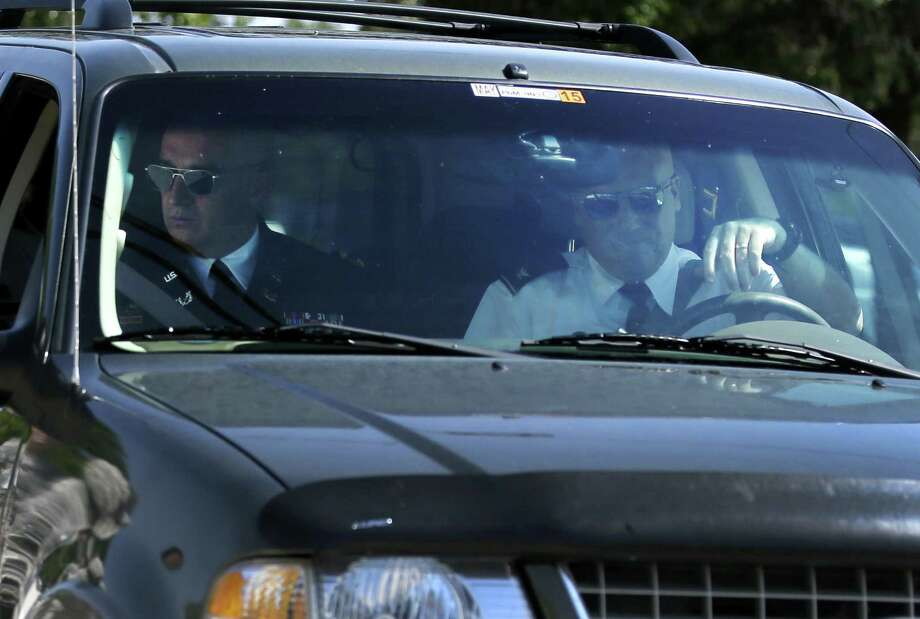 Army Col. Mike Mulligan (left), the lead prosecutor in the trial of Maj. Nidal Hasan arrives at Fort Hood. Photo: Tony Gutierrez / Associated Press