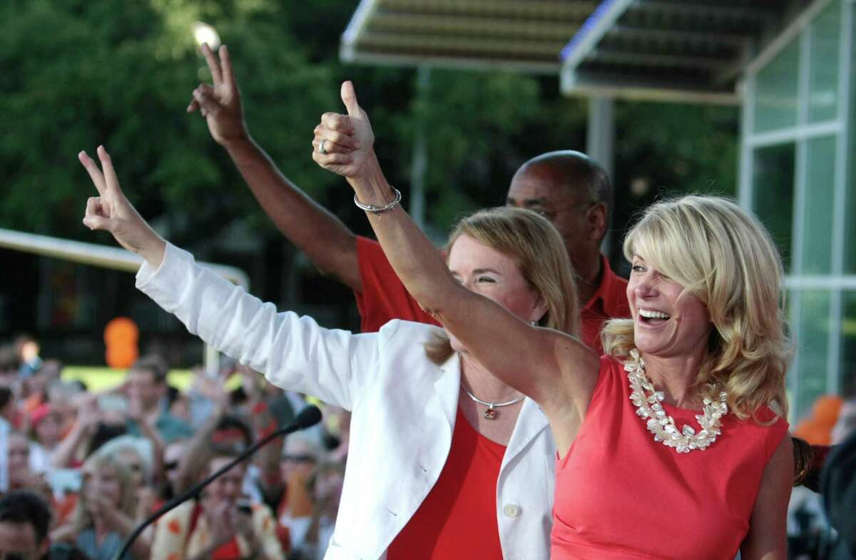 State Sen. Wendy Davis gives the thumbs up to the crowd during the Planned Parenthood Action Fund's Stand with Texas Women Rally at Discovery Green in Houston in July.