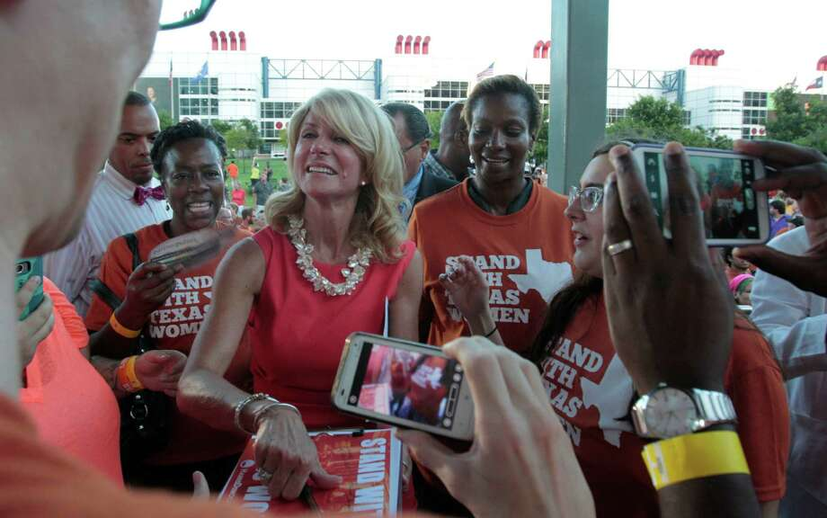 State Sen. Wendy Davis signs autographs and takes photos with the crowd during the Planned Parenthood Action Fund's Stand with Texas Women Rally at Discovery Green. Photo: Billy Smith II, Chronicle / © 2013 Houston Chronicle