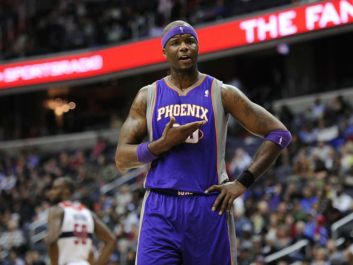 In this March 16, 2013, photo, Phoenix Suns center Jermaine O'Neal (20) gestures during the Suns' NBA basketball game against the Washington Wizards in Washington. The Warriors added some depth by reaching agreements with guard Toney Douglas and center O'Neal on Tuesday, July 9, 2013, a person with knowledge of the situation said. The person spoke on condition of anonymity because teams can't confirm moves until the new league year begins Wednesday. Both are believed to be one-year contracts. (AP Photo/Nick Wass)