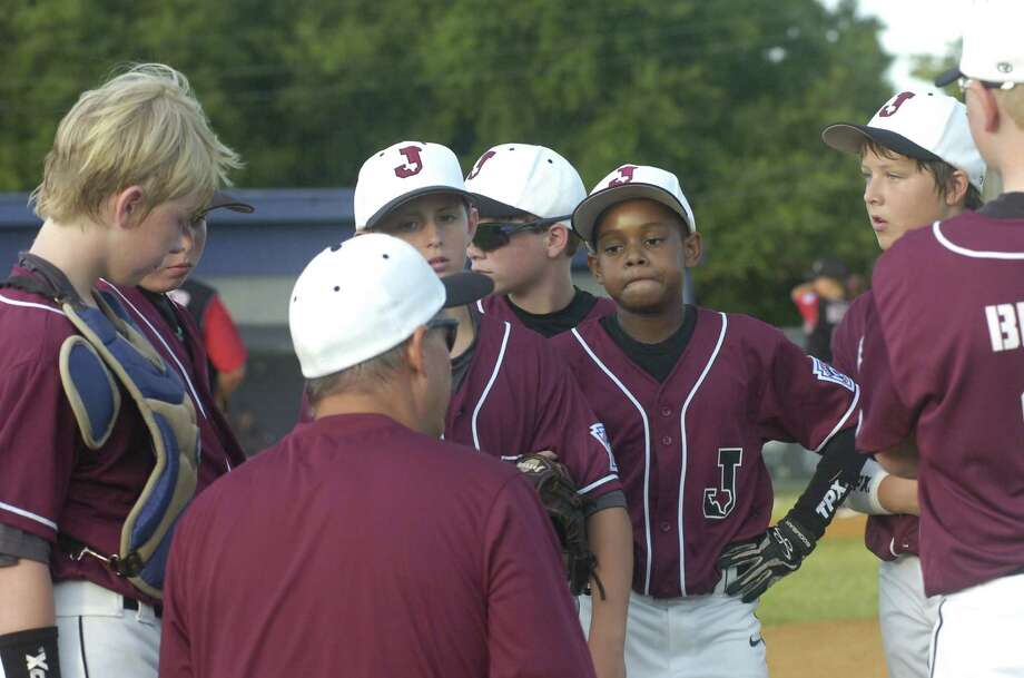 Jasper 12-year-old All-Stars coach Wade Womack adresses his players after the first inning of Tuesday's Section 2 Tournament game against North Shore. Photo: Avi Zaleon
