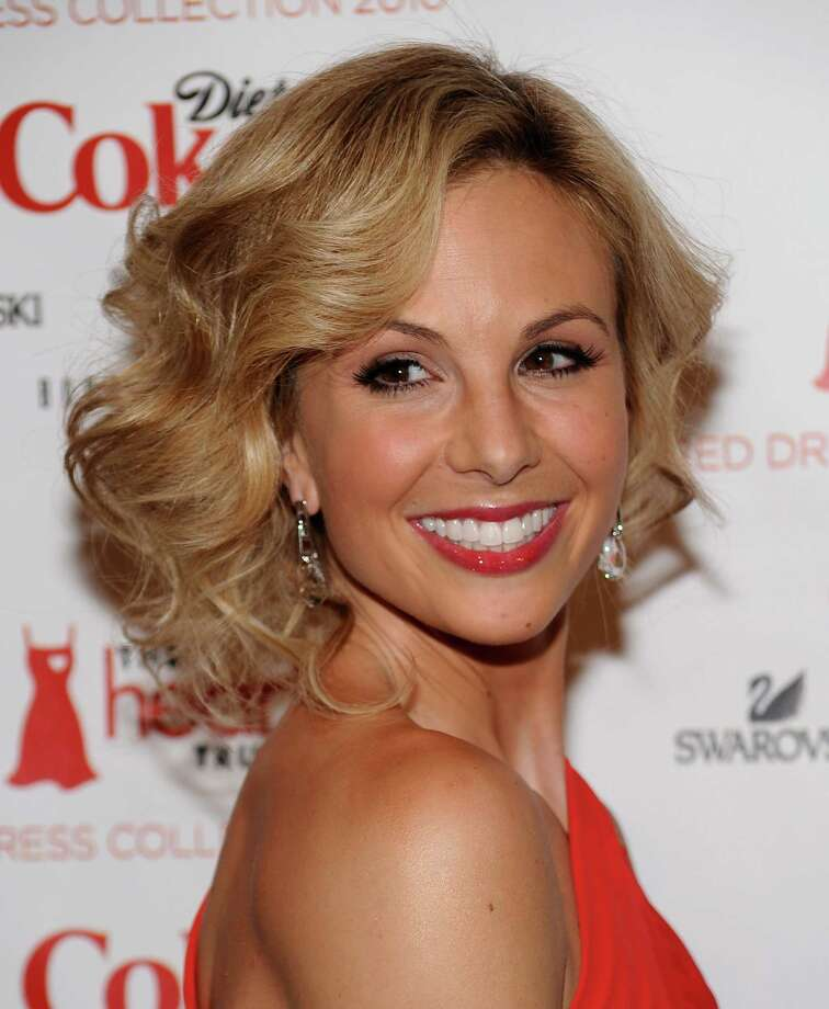 "FILE - In this Feb. 11, 2010 file photo, television personality Elisabeth Hasselbeck arrives at The Heart Truth's Red Dress Collection 2010 fashion show in New York. Hasselbeck is leaving the desk at ""The View"" for the couch on Fox News Channel's ""Fox & Friends."" The news network said Tuesday, July 9, 2013, that Hasselbeck, who has been on Barbara Walters' syndicated daytime show for a decade, will join co-anchors Steve Doocy and Brian Kilmeade on Fox's morning show in September. (AP Photo/Evan Agostini, File) Photo: Evan Agostini, FRE / AP"