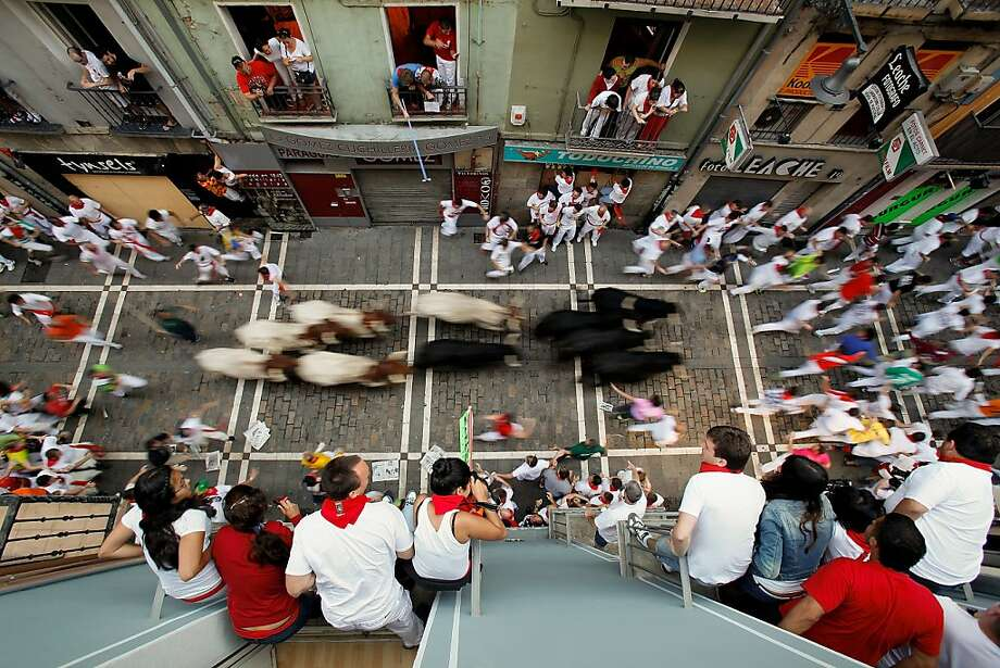 PAMPLONA, SPAIN - JULY 09:  Revelers run with Valdefresno's ranch fighting bulls at Calle Estafeta during the fourth day of the San Fermin Running Of The Bulls festival, on July 9, 2013 in Pamplona, Spain. The annual Fiesta de San Fermin, made famous by the 1926 novel of US writer Ernest Hemmingway 'The Sun Also Rises', involves the running of the bulls through the historic heart of Pamplona, this year for nine days from July 6-14.  (Photo by Pablo Blazquez Dominguez/Getty Images) Photo: Pablo Blazquez Dominguez, Getty Images