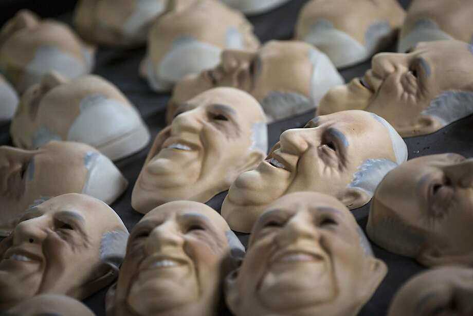 Masks in the likeness of Pope Francis dry at the Condal mask-making factory ahead of the pontiff's visit in Sao Goncalo near Rio de Janeiro, Brazil, Tuesday, July 9, 2013.  The pope's July 22-29 visit to Brazil, the world's largest Roman Catholic country, will be his first foreign trip as pontiff. (AP Photo/Felipe Dana) Photo: Felipe Dana, Associated Press