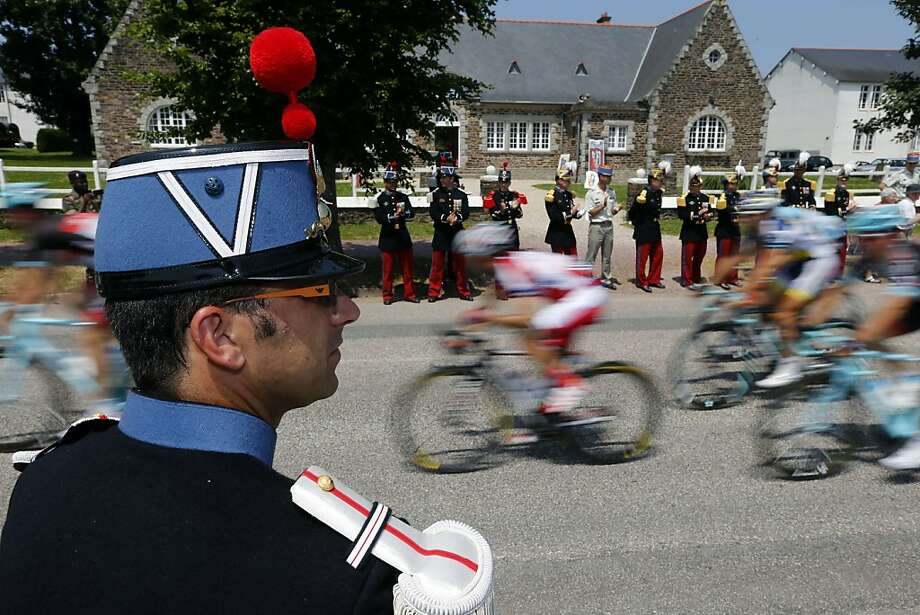Members of  the Ecole Speciale Militaire de Saint-Cyr (Special Military School of Saint-Cyr) stand along the road as cyclists ride past during the 197 km tenth stage of the 100th edition of the Tour de France cycling race on July 9, 2013 between Saint-Gildas-des-Bois and Saint-Malo, northwestern France.  AFP PHOTO / JOEL SAGETJOEL SAGET/AFP/Getty Images Photo: Joel Saget, AFP/Getty Images
