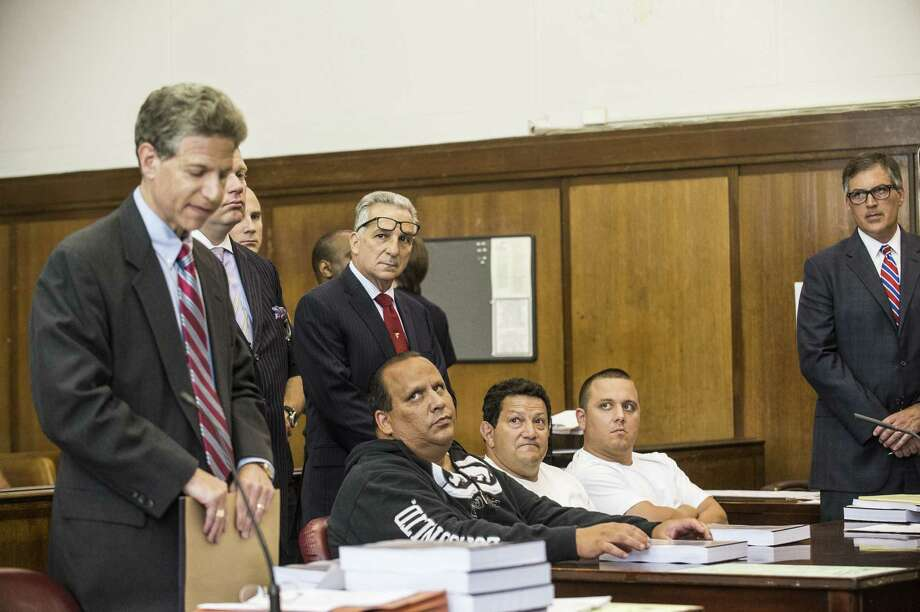 Anthony Santoro (seated, from left), Vito Badamo and Ernest Aiello are among those named in an indictment that accuses them of gambling, loan-sharking and extortion. Photo: Robert Stolarik / New York Times