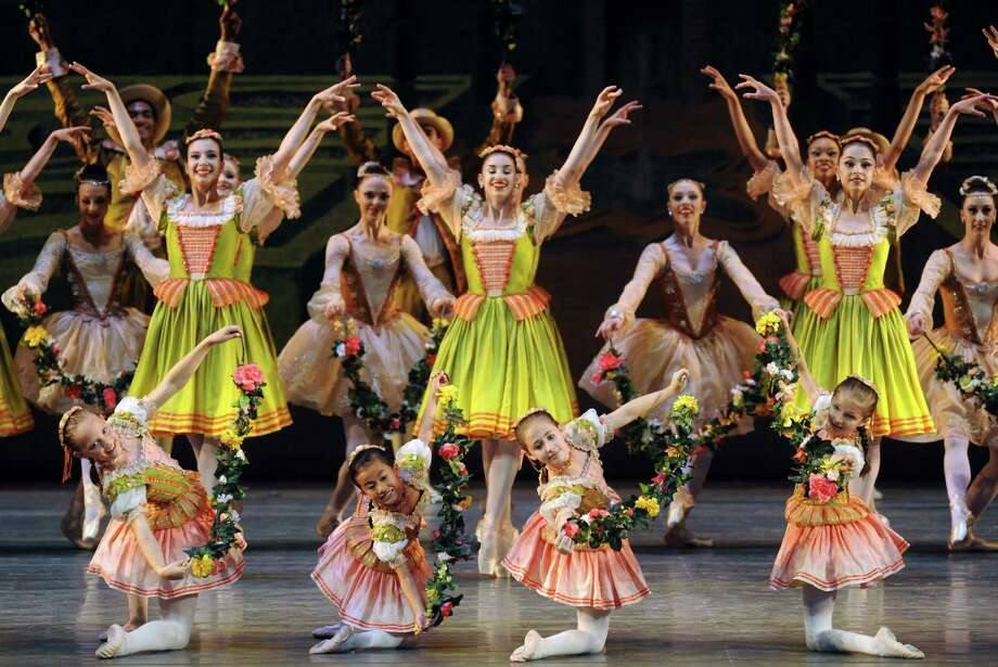 The New York City Ballet with local dance school students perform The Garland Dance during the ballet's opening night at SPAC on Tuesday July 9, 2013 in Saratoga Springs, N.Y. (Michael P. Farrell/Times Union) Photo: Michael P. Farrell / 00023097A