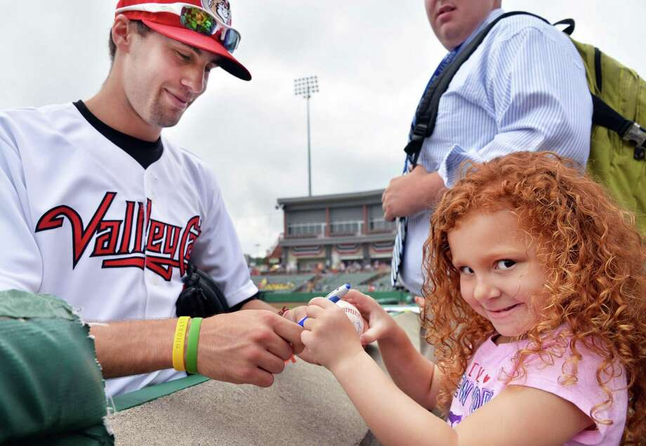 Five-year-old Peyton Stavrou pf North Greenbush gets an autograph from Tri-City ValleyCats' second baseman Thomas Lindauer before Tuesday's game against Aberdeen at Bruno Stadium Tuesday July 9, 2013, in Troy, N.Y.  (John Carl D'Annibale / Times Union) Photo: John Carl D'Annibale / 00023064A