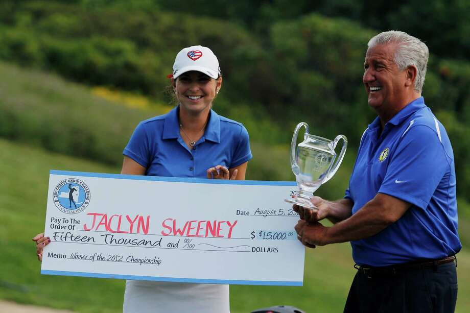 Albany Mayor Jerry Jennings presents a check for fifteen thousand dollars and the trophy for winning the Credit Union Challenge to Jaclyn Sweeney of Bradenton, Fla., at Capital Hills Golf Course, Sunday Aug. 5, 2012 in Albany, N.Y. Sweeney captured her first Symetra Tour victory with a score of 3 under par on the final round to win the Credit Union Challenge. (Dan Little/Special to the Times Union) Photo: Dan Little / Dan Little