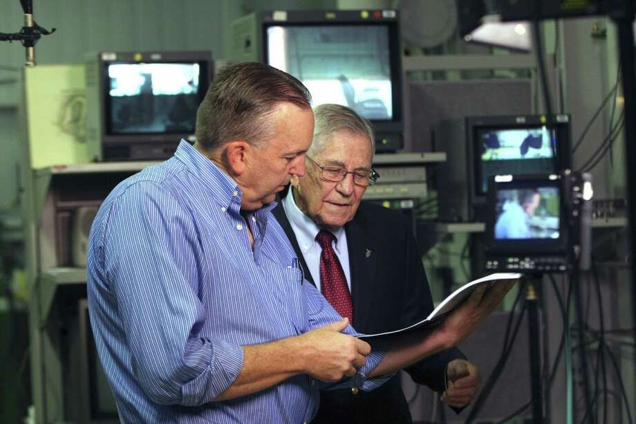 Documentarian Robert Erickson discusses the project with Billy Welch, a retired Air Force civilian scientist, at Brooks City-Base. Photo: Helen L. Montoya, San Antonio Express-News