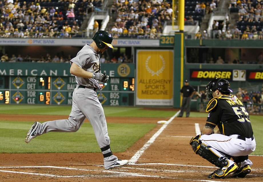 PITTSBURGH, PA - JULY 09:  Brandon Moss #37 of the Oakland Athletics touches home after hitting a two run home run in the fourth inning against the Pittsburgh Pirates during the game on July 9, 2013 at PNC Park in Pittsburgh, Pennsylvania.  (Photo by Justin K. Aller/Getty Images) Photo: Justin K. Aller, Getty Images