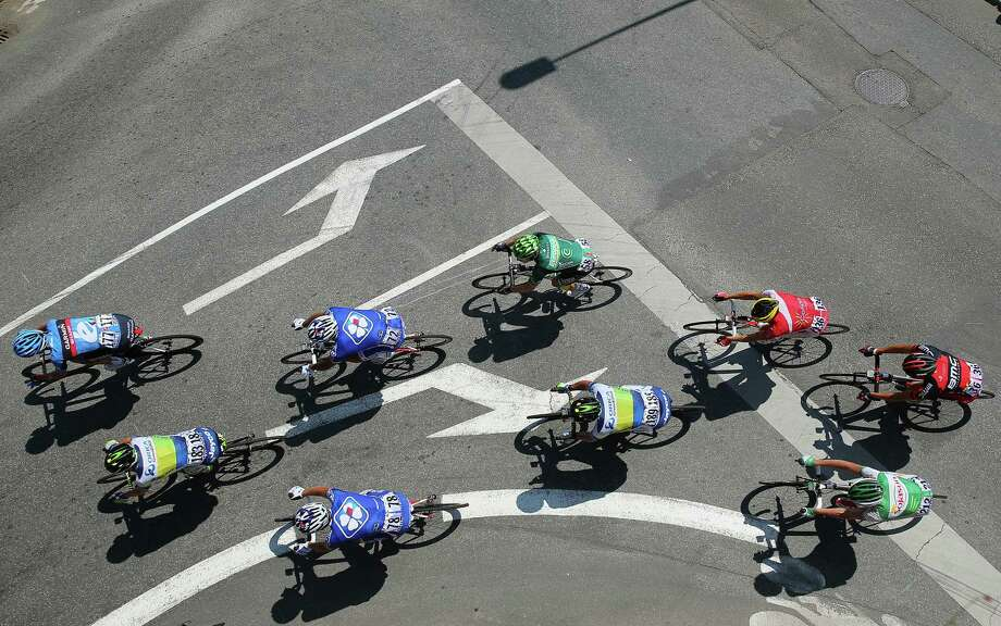 Cyclists competing in Tuesday's 10th stage of the Tour de France stay on course by ignoring the traffic markings on the street in St. Malo, France. Photo: Bryn Lennon, Staff / 2013 Getty Images
