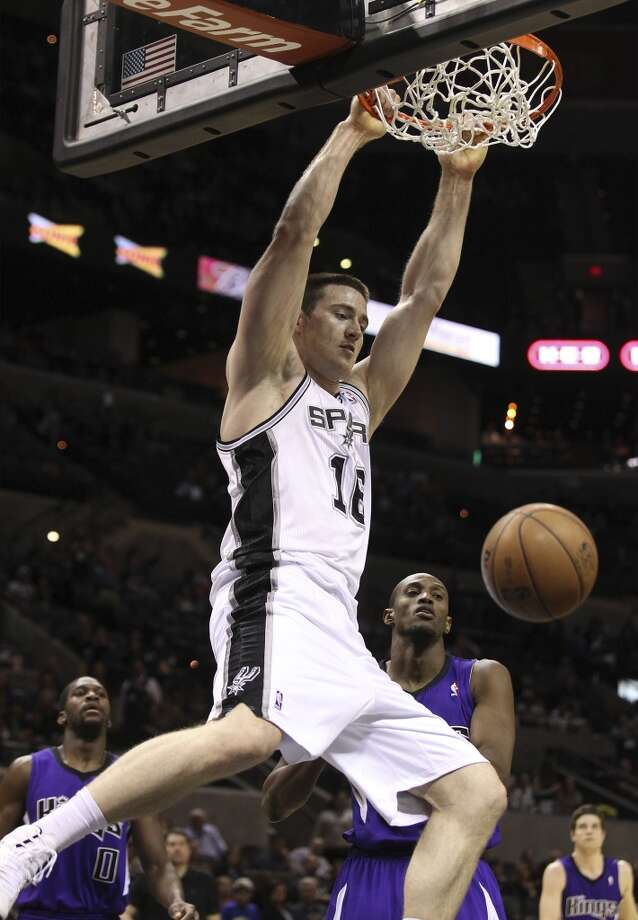 16 Aron Baynes, center, 6-10, 260, Washington State/Australia  PHOTO: The Spurs' Baynes dunks against the Sacramento Kings at the AT&T Center on March 1, 2013. (Kin Man Hui / San Antonio Express-News)