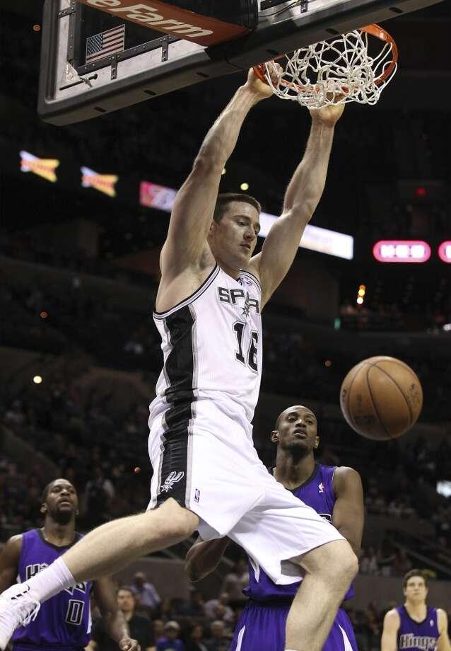 16 Aron Baynes, center, 6-10, 260, Washington State/AustraliaPHOTO: The Spurs' Baynes dunks against the Sacramento Kings at the AT&T Center on March 1, 2013. (Kin Man Hui / San Antonio Express-News)