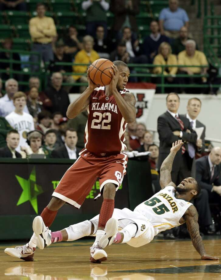 14 Amath M'Baye, forward, 6-9, 208, Oklahoma/France  PHOTO: M'Baye looks over his shoulder after being fouled by Baylor 's Pierre Jackson during a game on Jan. 30, 2013, in Waco. (Tony Gutierrez / Associated Press)