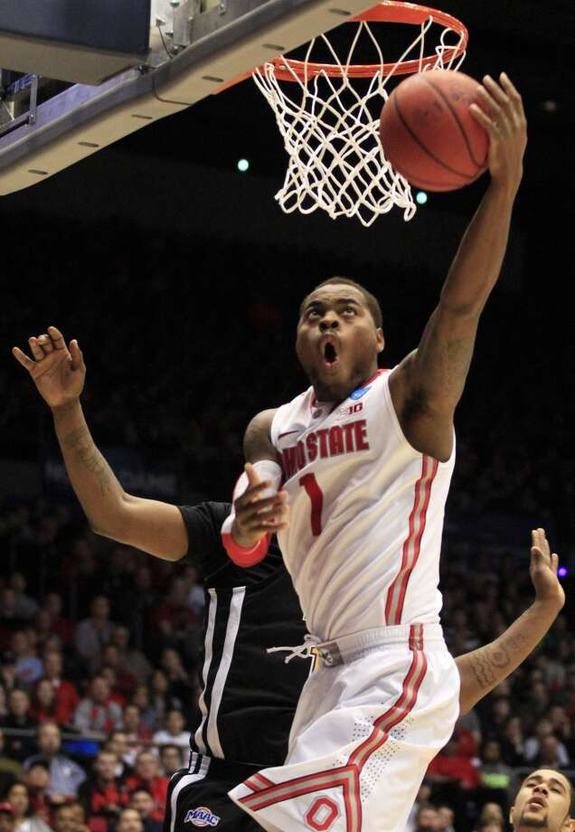 22 Deshaun Thomas, forward, 6-7, 225, Ohio State/USA  PHOTO: Thomas shoots a reverse layup against Iona in a second-round game at the NCAA college basketball tournament on March 22, 2013, in Dayton, Ohio. (Skip Peterson / Associated Press)
