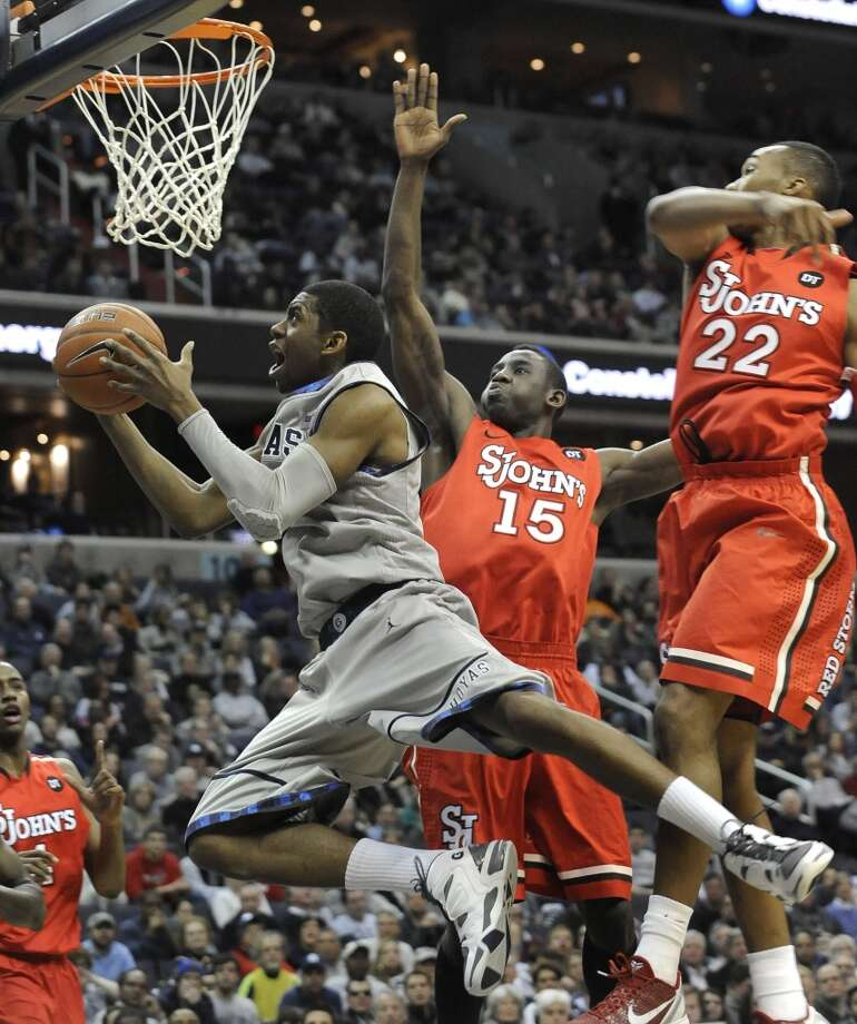 17 Hollis Thompson, forward, 6-8, 212, Georgetown/USA  PHOTO: Thompson drives in for a reverse layup against the defense of St. John's Amir Garrett (22) and Sir'Dominic Pointer (15) during a game on Feb. 12, 2012, in Washington. (Richard Lipski / Associated Press)