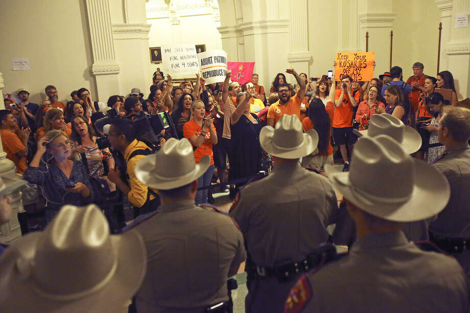 Abortion-rights advocates chant outside the House chamber after state representatives voted 98-49 to give the initial OK to House Bill 2, which would ban abortion at 20 weeks and impose stricter standards for clinics. Photo: Photos By Tom Reel / San Antonio Express-News