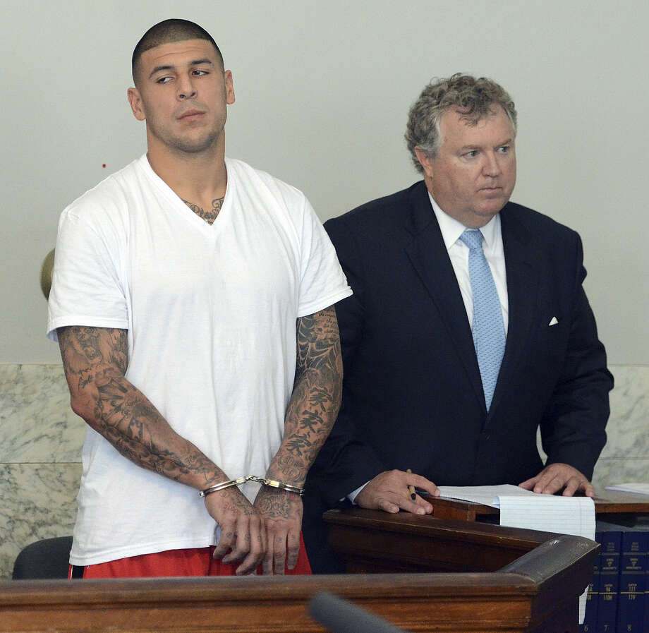 Former Patriots tight end Aaron Hernandez, with attorney Michael Fee in court on June 26, is charged with murder in the June killing of semi-pro football player Odin Lloyd. Photo: Mike George / Associated Press