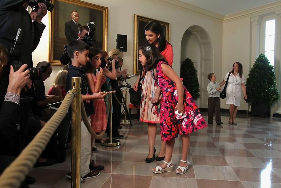 "Emma Scielzo, 10, center, with her mother Asha Scielzo, of Chevy Chase, Md., is interviewed by ""kid reporters"" for an online magazine, whose mother asked that their names not be used, during arrivals for at the Kid's ""State Dinner"" event, Tuesday, July 9, 2013, in the East Room of the White House in Washington. The event recognizes 54 winners of a nationwide recipe challenge to promote healthy lunches representing all U.S. states, three territories and the District of Columbia.  (AP Photo/Jacquelyn Martin) Photo: Jacquelyn Martin, Associated Press"