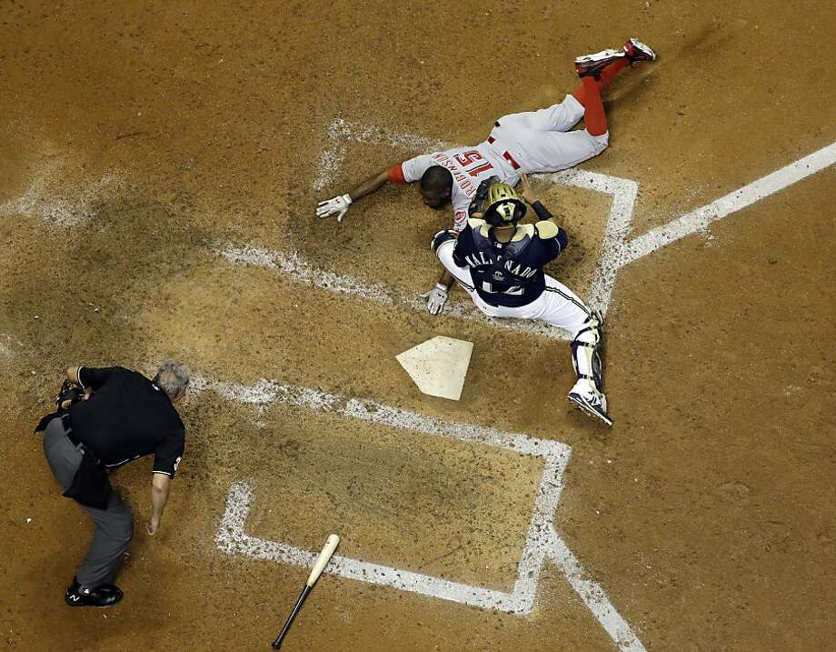 Milwaukee Brewers catcher Martin Maldonado tags out Cincinnati Reds' Derrick Robinson at home during the seventh inning of a baseball game Tuesday, July 9, 2013, in Milwaukee. Robinson was out trying to stretch a triple into an inside-the-park home run. (AP Photo/Morry Gash) Photo: Morry Gash, Associated Press