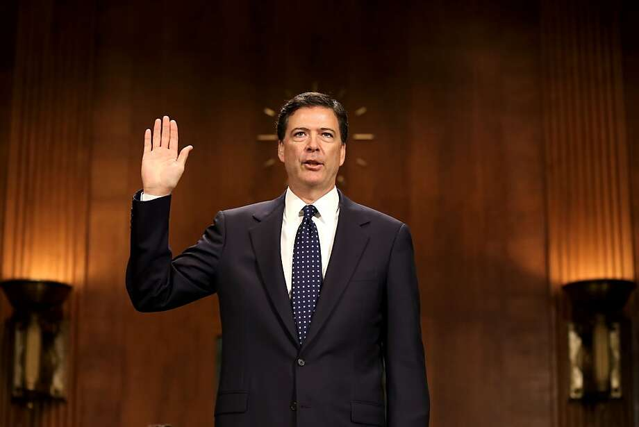 WASHINGTON, DC - JULY 09:  James Comey Jr., nominee to be director of the Federal Bureau of Investigation (FBI) is sworn in for his Senate Judiciary Committee confirmation hearing on Capitol Hill July 9, 2013 in Washington, DC. If confirmed by the U.S. Senate, Mr. Comey will replace Robert Mueller III to become the eighth director of the FBI.  (Photo by Mark Wilson/Getty Images) Photo: Mark Wilson, Getty Images