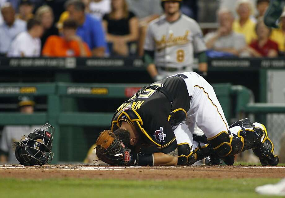 PITTSBURGH, PA - JULY 09:  Russell Martin #55 of the Pittsburgh Pirates reacts after being injured in the first inning against the Oakland Athletics during the game on July 9, 2013 at PNC Park in Pittsburgh, Pennsylvania.  (Photo by Justin K. Aller/Getty Images) Photo: Justin K. Aller, Getty Images