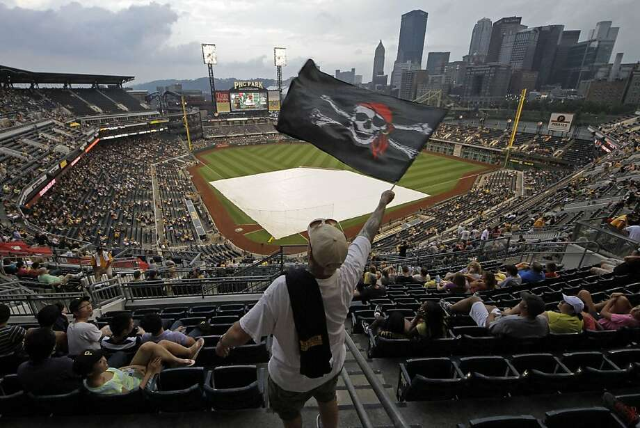 Pittsburgh Pirates fan Brandon Marto of Pittsburgh waits out a rain delay in the upper deck of PNC Park before a baseball game between the Pittsburgh Pirates and Oakland Athletics in Pittsburgh,  Tuesday, July 9, 2013. (AP Photo/Gene J. Puskar) Photo: Gene J. Puskar, Associated Press