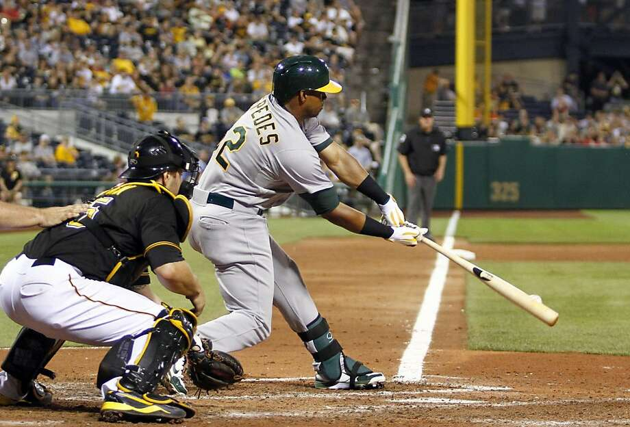 PITTSBURGH, PA - JULY 09:  Yoenis Cespedes #52 of the Oakland Athletics grounded into fielder's choice in the ninth inning against the Pittsburgh Pirates during the game on July 9, 2013 at PNC Park in Pittsburgh, Pennsylvania.  Oakland defeated the Pirates 2-1.  (Photo by Justin K. Aller/Getty Images) Photo: Justin K. Aller, Getty Images
