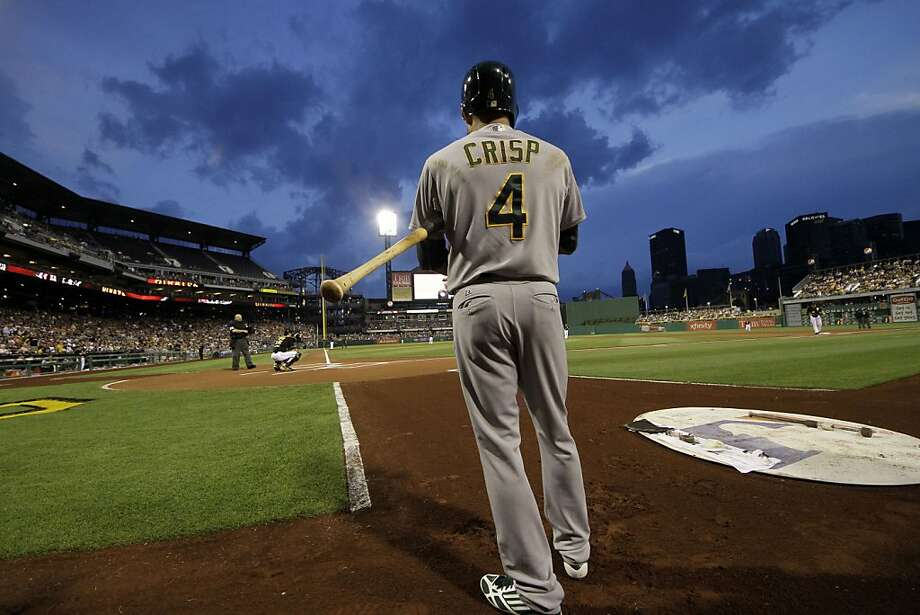 Oakland Athletics' Coco Crisp (4) stands on deck before the beginning of a baseball game against the Pittsburgh Pirates at PNC Park in Pittsburgh Tuesday, July 9, 2013. The Athletics won 2-1. (AP Photo/Gene J. Puskar) Photo: Gene J. Puskar, Associated Press