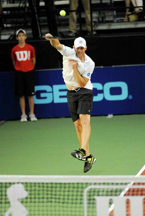 Andy Roddick of the Springfield Lasers, hits a overhead return against the New York Sportimes in a World Team Tennis doubles match at SEFCU Arena in Albany, N.Y., Tuesday, July 9, 2013. (Hans Pennink / Special to the Times Union) ORG XMIT: HP104 Photo: Hans Pennink / Hans Pennink