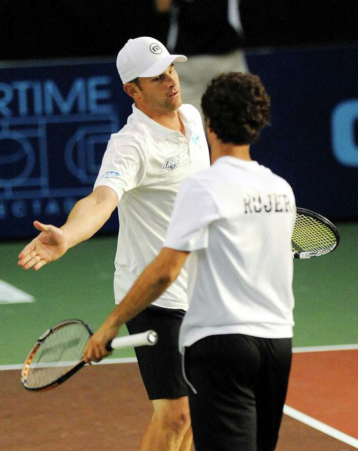 Andy Roddick ,left and Jean Julien Rojer of the Springfield Lasers, celebrate a point against the New York Sportimes in a World Team Tennis match at SEFCU Arena in Albany, N.Y., Tuesday, July 9, 2013. (Hans Pennink / Special to the Times Union) ORG XMIT: HP108 Photo: Hans Pennink / Hans Pennink