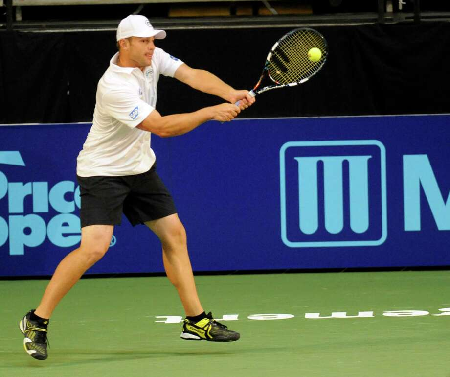 Andy Roddick of the Springfield Lasers, returns the ball against the New York Sportimes in a World Team Tennis doubles match at SEFCU Arena in Albany, N.Y., Tuesday, July 9, 2013. (Hans Pennink / Special to the Times Union) ORG XMIT: HP103 Photo: Hans Pennink / Hans Pennink