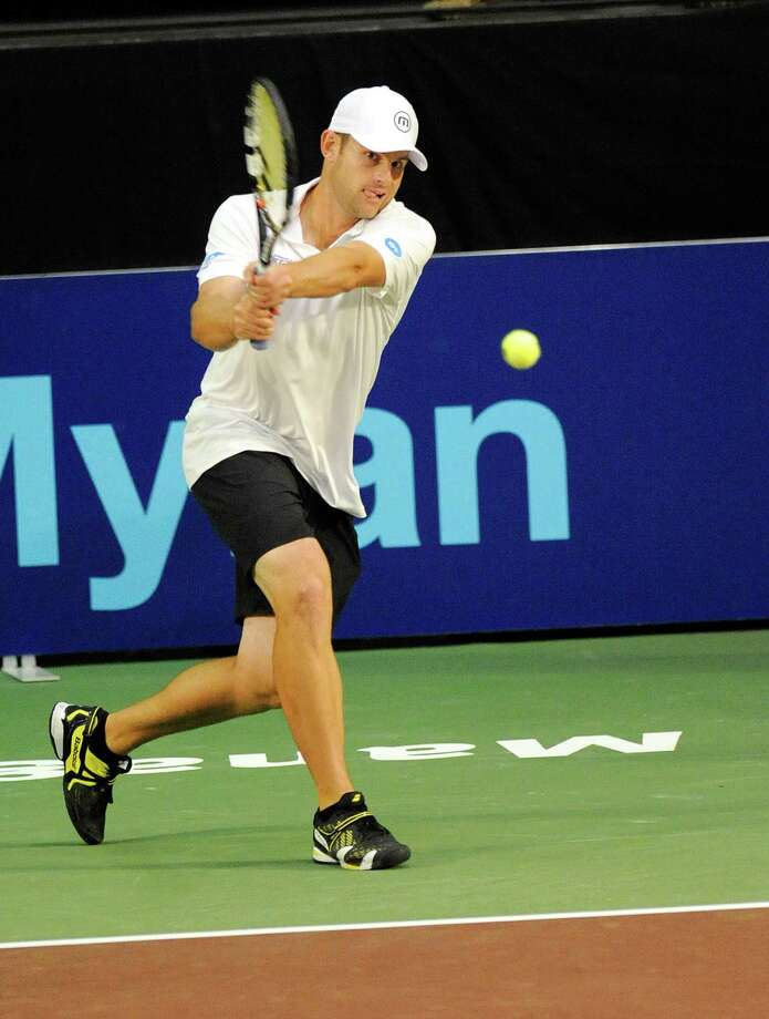 Andy Roddick of the Springfield Lasers, returns the ball against the New York Sportimes in a World Team Tennis doubles match at SEFCU Arena in Albany, N.Y., Tuesday, July 9, 2013. (Hans Pennink / Special to the Times Union) ORG XMIT: HP102 Photo: Hans Pennink / Hans Pennink