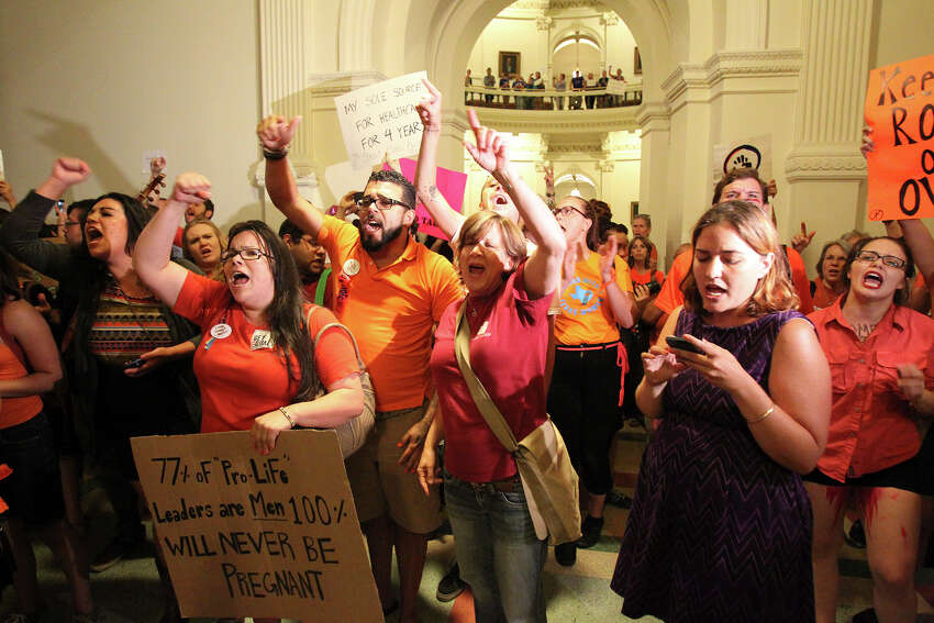 Protestors rant outside the House chamber after the House of Representatives passed abortion legislation on July 9, 2013.