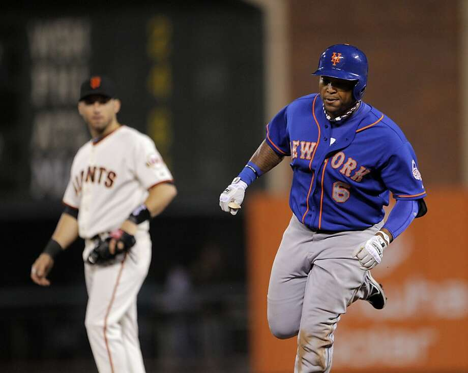 The Mets' Marlon Byrd rounds the bases with Marco Scutaro in the background after he hit a grand slam in the eighth inning. Photo: Carlos Avila Gonzalez, The Chronicle