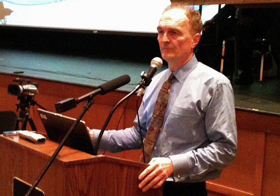 Charles Firlotte, CEO and president of Aquarian Water Co., makes a presentation Tuesday night during the Public Utilities Regulatory Authority's second public hearing in Fairfield on Aquarion's proposed rate hikes. Photo: Andrew Brophy / Fairfield Citizen contributed