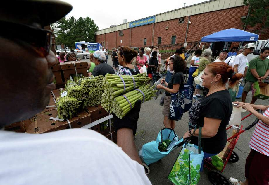 A large number of people showed up for the free mass food distribution at the Salvation Army parking in collaboration with the Trinity Alliance Tuesday, July 9, 2013, in Albany, N.Y. (Skip Dickstein/Times Union) Photo: Skip Dickstein / 00023093A