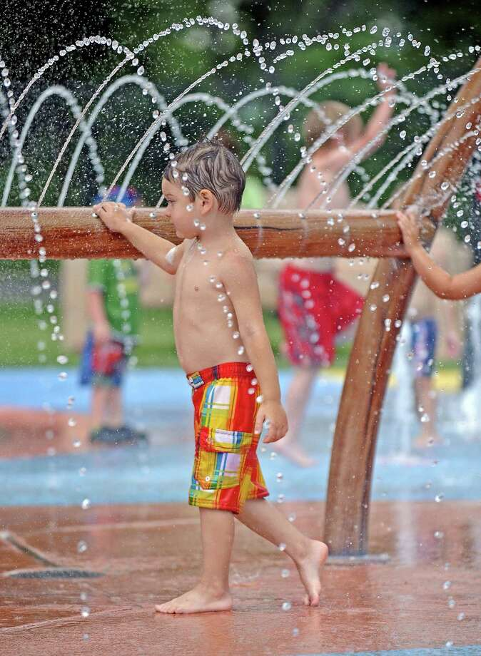 Kane Rivas, 3, of Port Acres plays at the Port Neches Spray Park on Wednesday, June 5, 2013. Photo taken: Randy Edwards/The Enterprise Photo: Randy Edwards