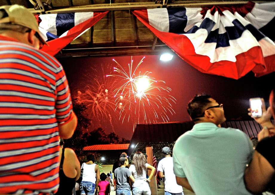 Beaumont residents slowly fill the park and the Neches River during the firework show at the City of Beaumont Fourth of July Celebration on Thursday, July 4, 2013 at Riverfront Park. Photo taken: Randy Edwards/The Enterprise Photo: Randy Edwards