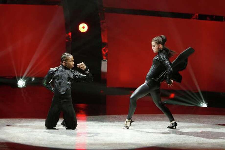 "SO YOU THINK YOU CAN DANCE: L-R: Contestants Amy Yakima and Fik-Shun perform a Paso Doble routine to ""Tactical Dominance"" choreographed by Jean-Marc Genereux on SO YOU THINK YOU CAN DANCE airing Tuesday, July 9 (8:00-10:00 PM ET/PT) on FOX. ©2013 FOX Broadcasting Co. Cr: Adam Rose / 1"