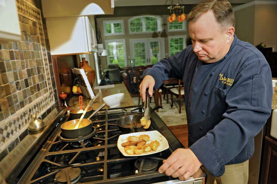 Chef Dale Miller browns the meat for the restaurant version of his Chicken, Shrimp and Andouille Jambalaya at his home on Monday, July 1, 2013 in Clifton Park, N.Y. (Lori Van Buren / Times Union) Photo: Lori Van Buren / 00022896A