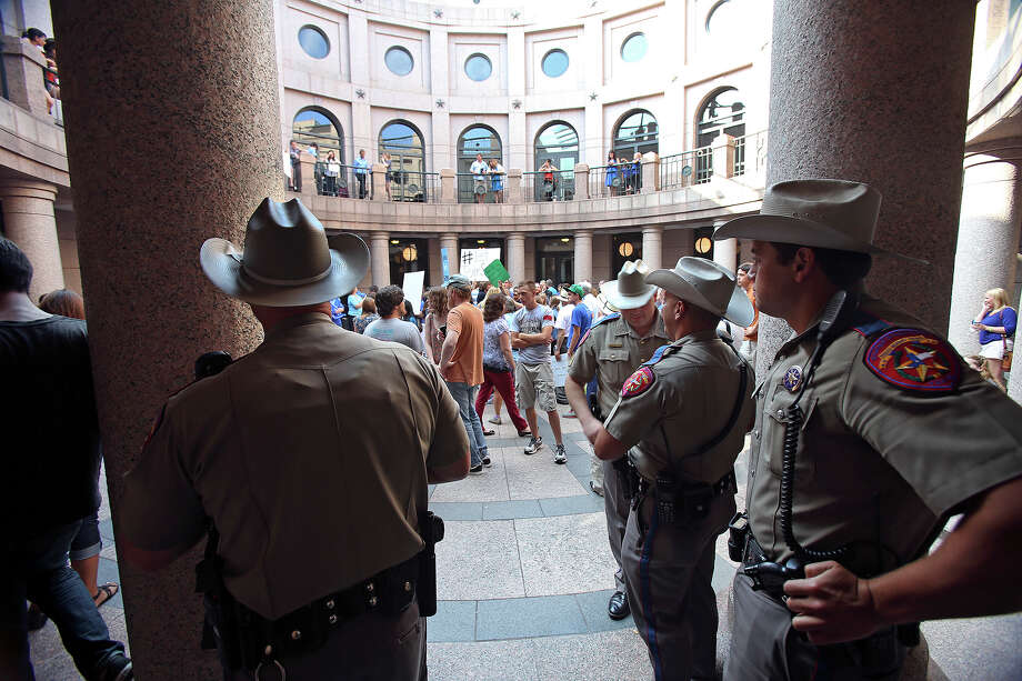 DPS troopers hang out in the hallways as supporters of both sides of the issue fill the Capitol building in Austin as a special committee hears testimony on Senate Bill 2  on July 1, 2013. Photo: TOM REEL