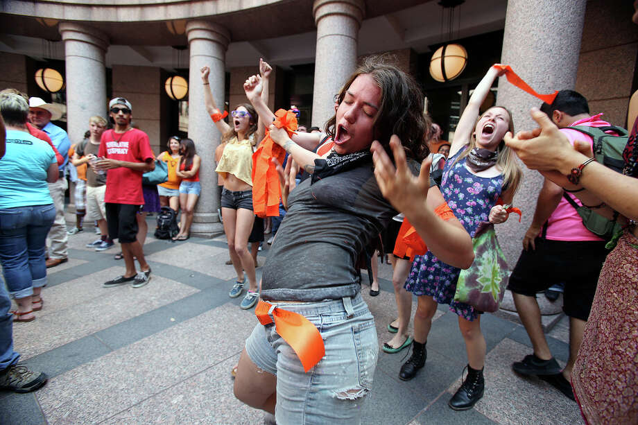 Caitlin Austin screams with her fellow protestors in an effort to overcome speakers in opposition as supporters of both sides of the issue fill the Capitol building in Austin as a special committee hears testimony on Senate Bill 2  on July 1, 2013. Photo: TOM REEL