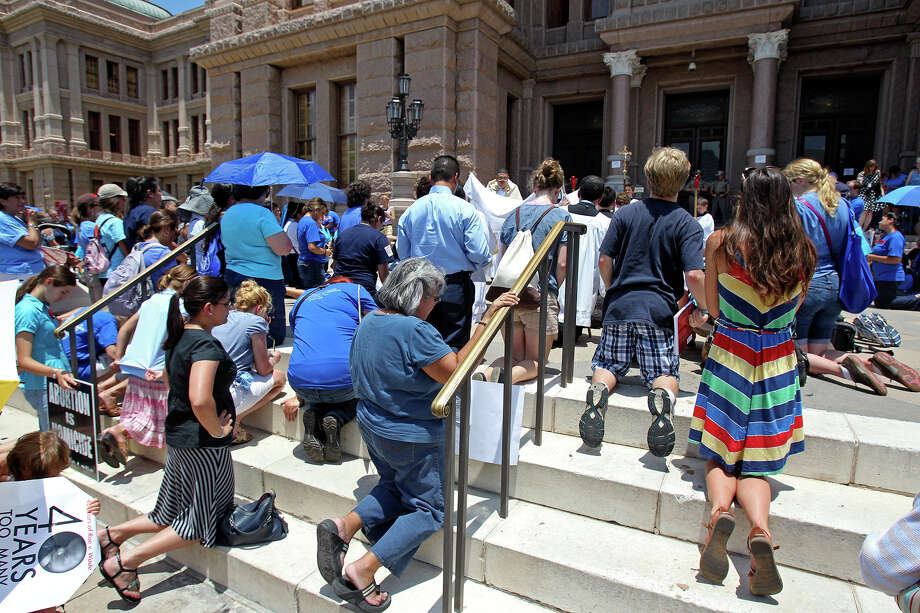 Signs were allowed as supporters of both sides of the issue fill the Capitol building in Austin as a special committee hears testimony on Senate Bill 2  on July 1, 2013. Photo: Tom Reel, San Antonio Express-News