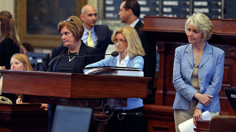 Ashley Granger speaks to a crowd in favor of abortion legislation as supporters of both sides of the issue fill the building in Austin as a special committee hears testimony on Senate Bill 2  on July 1, 2013. Photo: Tom Reel, San Antonio Express-News