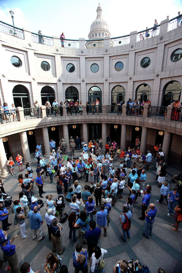 Those in favor of the legislation hold a speaking rally as supporters of both sides of the issue fill the Capitol building in Austin as a special committee hears testimony on Senate Bill 2  on July 1, 2013. Photo: Tom Reel, San Antonio Express-News