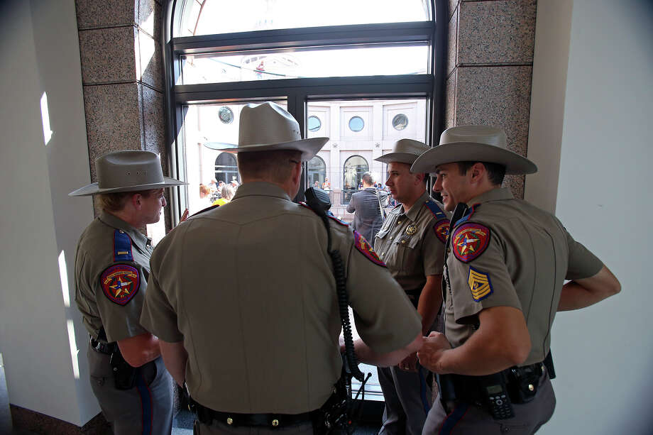 DPS officers remain on the sidelines as supporters of both sides of the issue fill the Capitol building in Austin as a special committee hears testimony on Senate Bill 2  on July 1, 2013. Photo: Tom Reel, San Antonio Express-News