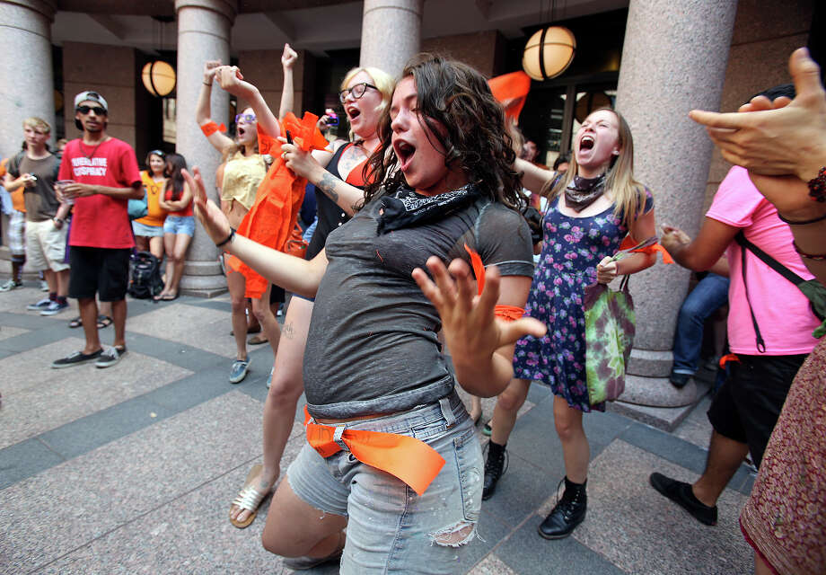Caitlin Austin screams with her fellow protestors in an effort to overcome speakers in opposition as supporters of both sides of the issue fill the Capitol building in Austin as a special committee hears testimony on Senate Bill 2  on July 1, 2013. Photo: Tom Reel, San Antonio Express-News